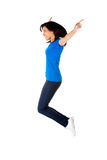 Young happy woman jumping in the air Stock Images