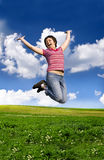 Young happy woman jumping high against blue sky. Young happy woman jumping high against blue summer sky Royalty Free Stock Photography