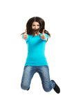 Young happy woman jumping with thumbs up Stock Photography