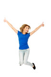 Young happy woman jumping with thumbs up. Royalty Free Stock Images