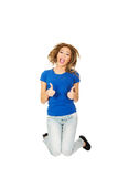 Young happy woman jumping with thumbs up. Royalty Free Stock Photo
