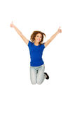 Young happy woman jumping with thumbs up. Stock Photography