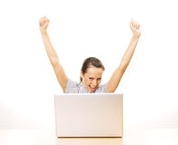 Young happy woman with laptop Royalty Free Stock Photography