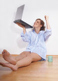 Young happy woman with a laptop Royalty Free Stock Photos