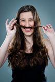 Young Happy Woman Laughing and Playing with Her Hair Royalty Free Stock Photo
