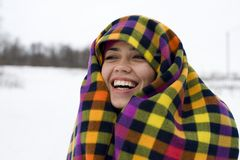 The young happy woman laughs having taken cover a Stock Photo