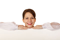 Young happy woman leans on blank billboard Stock Photos