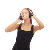 A young and happy woman listening to the music Stock Photos