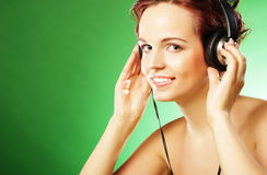 Young happy woman listening to music with headhones Royalty Free Stock Photo