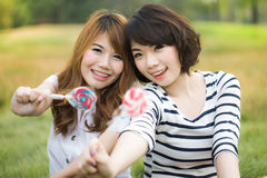 Young happy woman with lollipop Stock Image