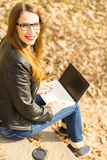 Young happy woman with long hair using laptop Stock Photography