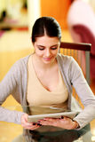 Young happy woman looking at tablet computer Stock Photos