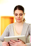Young happy woman looking at tablet computer Royalty Free Stock Images