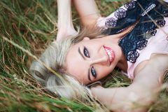 Young happy woman lying on the grass Outdoors Stock Photos