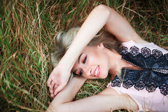 Young happy woman lying on the grass Outdoors Stock Images