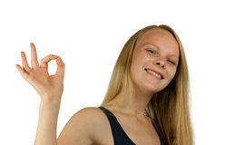 Young happy woman making OK gesture Royalty Free Stock Photo