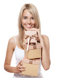 Young happy woman with a many gifts Royalty Free Stock Images
