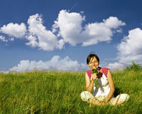 Young happy woman in meadow Stock Photo