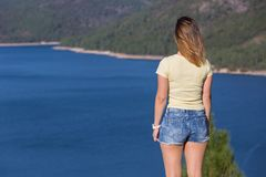 Girl enjoying the lake. Young happy woman at the mountain, relaxing and enjoying the lake at Geres, Portuguese National Park stock photos