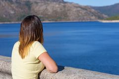 Girl enjoying the lake. Young happy woman at the mountain, relaxing and enjoying the lake at Geres, Portuguese National Park stock images