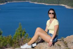 Girl enjoying the lake. Young happy woman at the mountain, relaxing and enjoying the lake at Geres, Portuguese National Park stock image