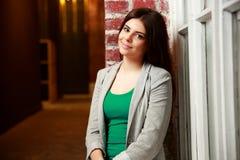 Young happy woman near brick wall Stock Photos