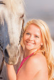 Young happy woman near the horse Royalty Free Stock Images