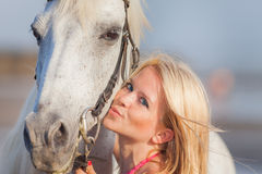 Young happy woman near the horse Royalty Free Stock Photos