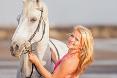 Young happy woman near the horse Stock Images