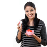 Young happy woman opening a gift box Stock Images
