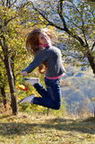 Young happy woman outdoor in autumn Royalty Free Stock Photography