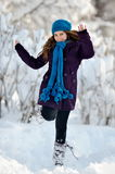 Young happy woman outdoor in winter enjoying the snow Royalty Free Stock Image