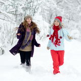 Young happy woman outdoor in winter enjoying the snow Stock Images
