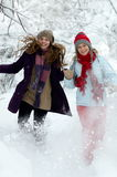 Young happy woman outdoor in winter  in  the snow Royalty Free Stock Images