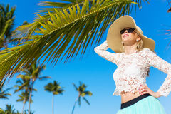Young happy woman with palm trees in background Royalty Free Stock Images