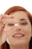 Young happy woman with pill Stock Photos