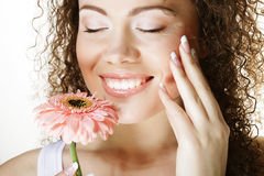 Young happy woman with pink flower royalty free stock photo