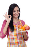 Young happy woman with plate of fruits Royalty Free Stock Images
