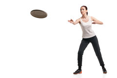 Young happy woman playing frisbee over white Royalty Free Stock Image