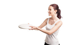 Young happy woman playing frisbee over white Stock Image