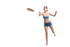 Young happy woman playing frisbee over white Royalty Free Stock Photography