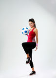 Young happy woman playing with soccer ball Stock Photography