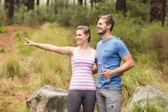 Young happy woman pointing in the distance next to her friend. Young happy women pointing in the distance next to her friend in the nature Stock Image