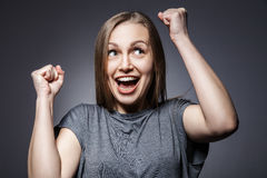 Young happy woman portrait on dark grey royalty free stock photography