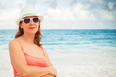 Young happy woman portrait on the ocean coast Stock Photography