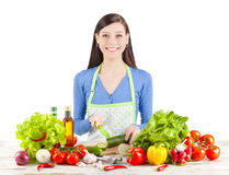Young happy woman preparing salad Stock Image