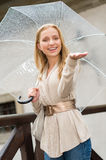 Young happy woman in rain with umbrella Royalty Free Stock Image