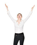 Happy woman with raised hands up in white shirt. Young happy woman with raised hands up in white shirt - isolated on white background Royalty Free Stock Photography