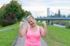Young happy woman raising hands while running Stock Image