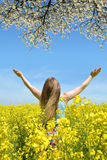 Young happy woman in the rapeseed field Royalty Free Stock Photos